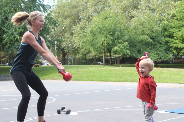 Shannon Mayo works out with support from her 2-year-old son, Miles.