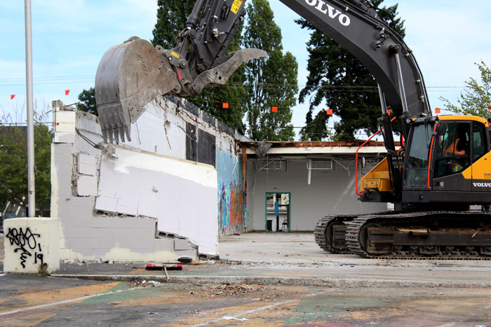 Photos by Brandon Macz: A demolition crew tears down old Midtown Center  retail buildings on Tuesday, Aug. 20.