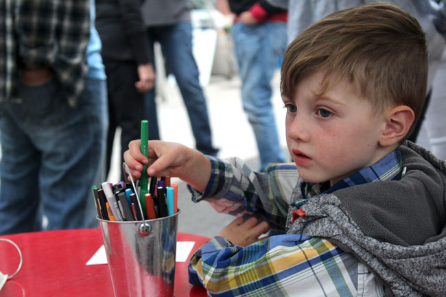 Children and adults worked on handwritten letters again this year at The Letter Farmer space in the Bank of America parking lot.
