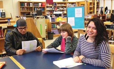 "<p><span>Seattle World School students Jesus Cabrera-Espinoza (left) and Shirley Mendez-Argueta (right) work with Bush School senior Nathalie Kent on their lines for their play ""Much Ado About Nothing."" </span>photo/Svetlana Mamedova</p>