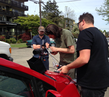 Crew members rig up a camera on a car for a scene that was filmed in Madison Park. Photo courtesy of Sudeshna Sen