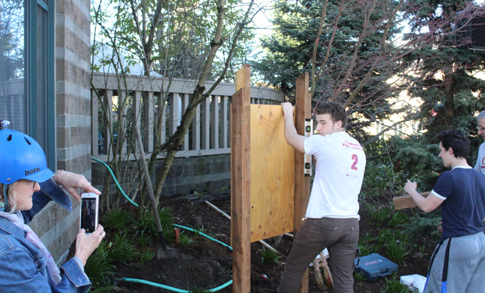 Tracy Krauter helps her son document the construction for his Eagle Scout project.